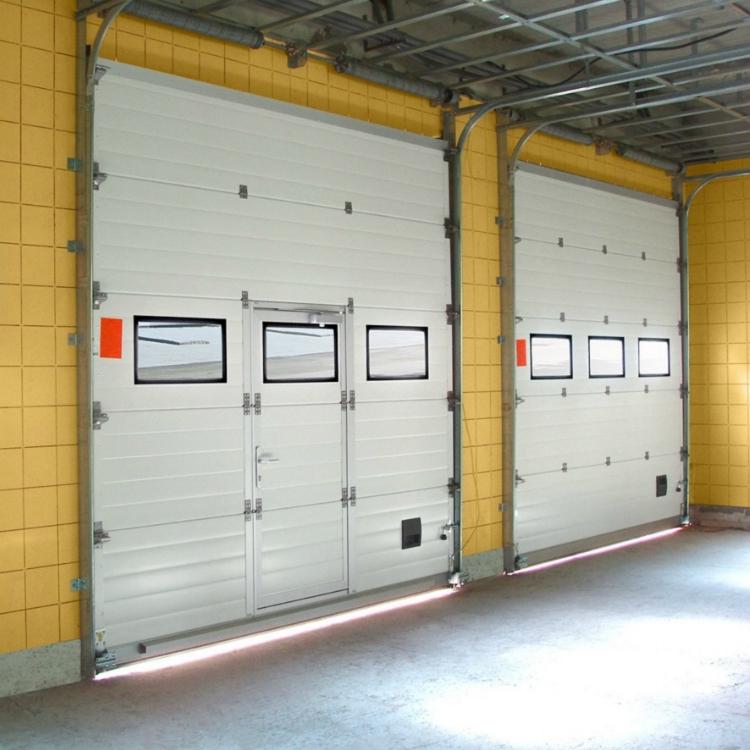 Гаражныеподъемно-секционные воротаГаражные секционные ворота обладают повышенной износостойкостью и выдерживают большие нагрузки, так как рассчитаны на высокую интенсивность эксплуатации и долгосрочную бесперебойную работу (до 100 тысяч циклов открывания/закрывания).