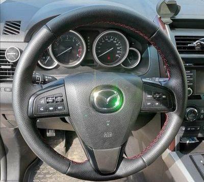 Руль Mazda 6цена 7000 p.Обтяжка руля натуральной автомобильной кожей (пр-во Италия) с красной прострочкой что добавляет спортивности.