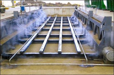 Используем технологиюпропаривания.Эта технология ускоряет процесс отвердения бетона в разы и позволяет получить70%-прочность бетона всего за 8 часов и отгружать уже на следующий день после заливки бетона