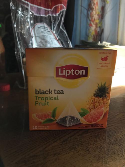 фото4 Чай черный Lipton Tropical Fruit байховый ароматизированный с кусочками фруктов, 20пак.