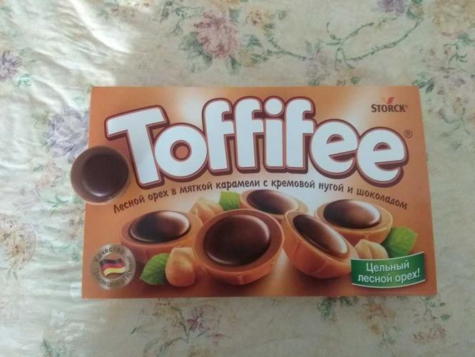 """стоимость Конфеты """"Тоффифи"""" (Toffifee) Лесной Орех в карамельной чашечке с нугой и шоколадом, 125гр."""