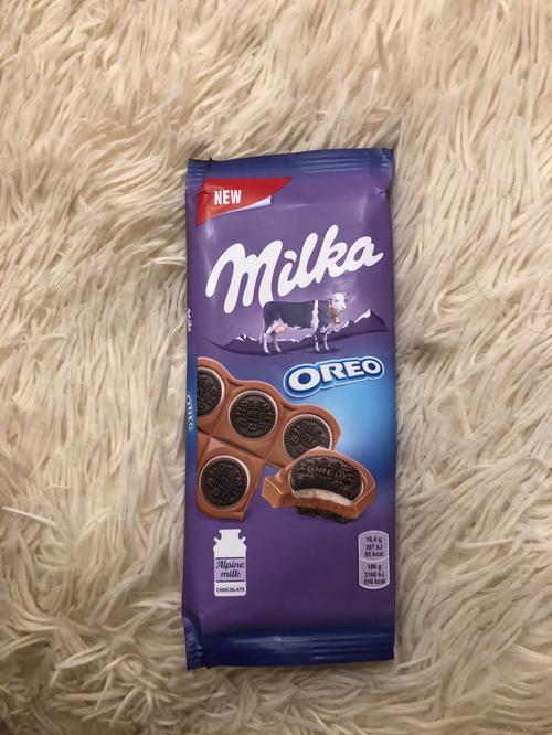"""описание Шоколад молочный """"Милка"""" с круглым печеньем Орео с начинкой из ванили"""