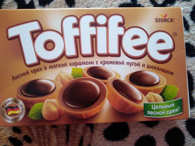 """описание Конфеты """"Тоффифи"""" (Toffifee) Лесной Орех в карамельной чашечке с нугой и шоколадом, 125гр."""
