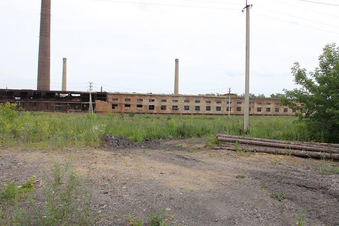 В Белове на территории Цинкового завода неизвестные устроили мусорный полигон и угольный склад