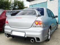 Бампер задний для Mitsubishi Lancer IX в стиле INGS Extreem под двойной выхлоп