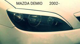 Реснички на фары для Mazda 2, Demio 2002-