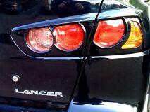 Накладки на задние фонари Mitsubishi Lancer 10